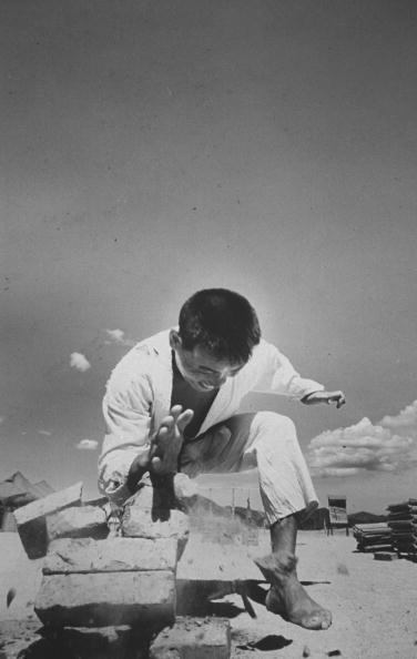 vintage martial artist breaking concrete blocks