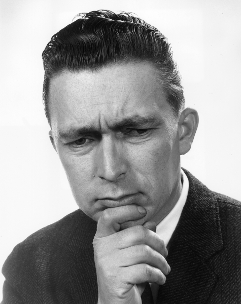 vintage man looking down with pensive look on face