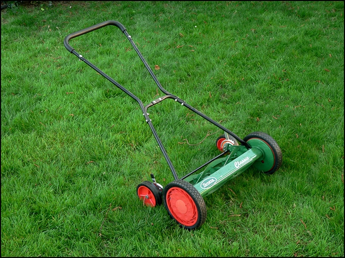 Scotts reel push mower on a lawn