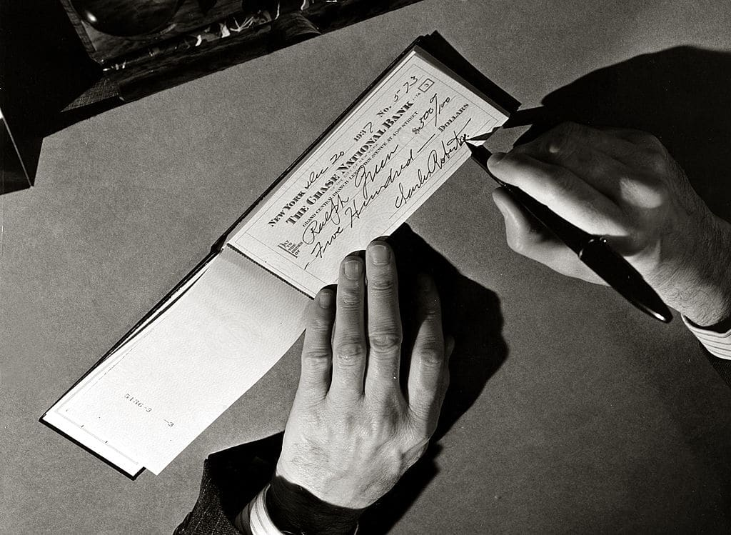 vintage man writing check