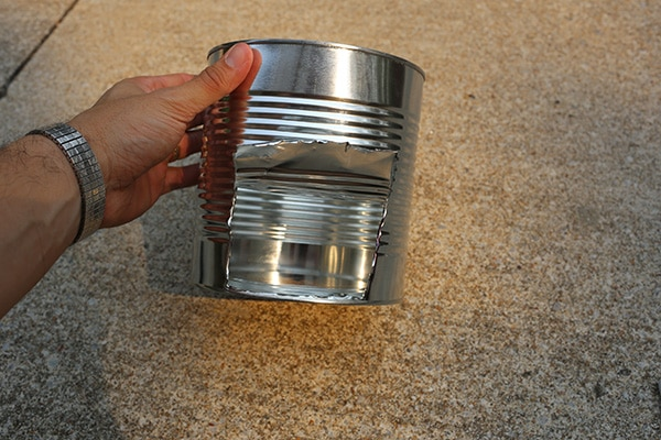 Hobo stove cut vent in bottom of can.