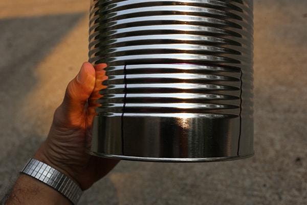 Hobo stove marking door at bottom of can.