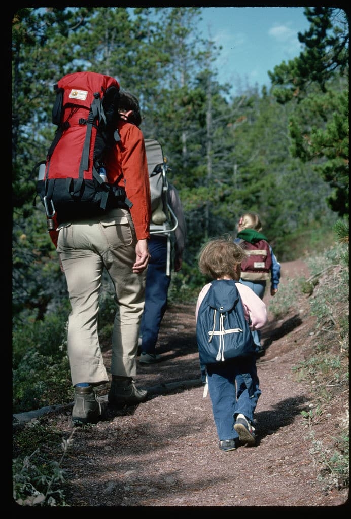 vintage family on a hike kids walking on trail