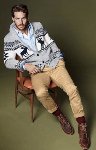 man wearing winter holiday cardigan and khakis