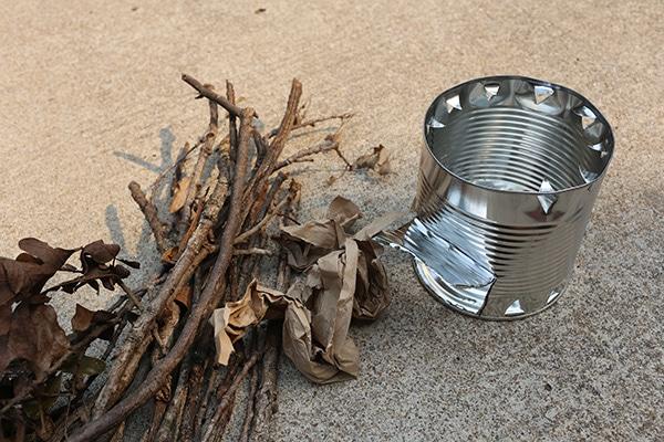 Hobo stove gathering fuel tinder kindling for fire.