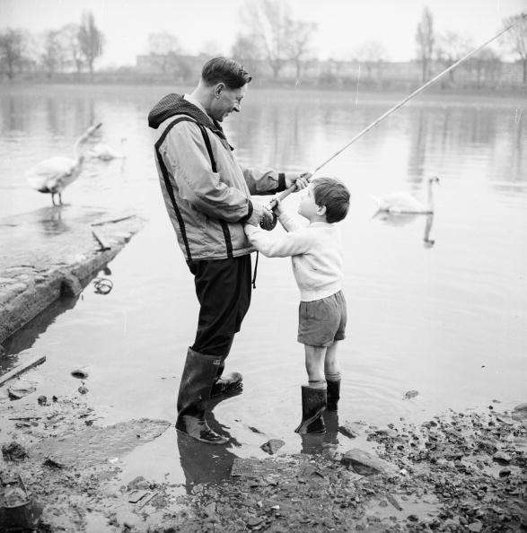 vintage father son fishing in lake