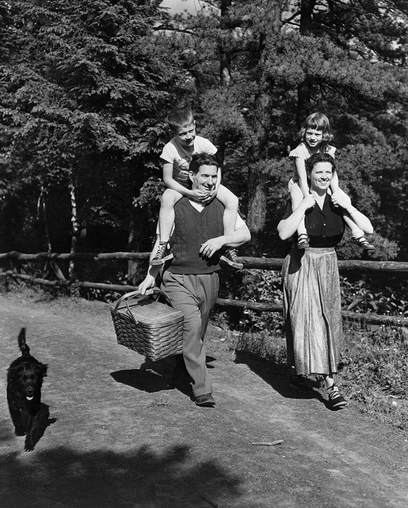 vintage family with kids walking to a picnic
