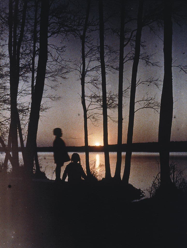 vintage kids playing at lake at sunset