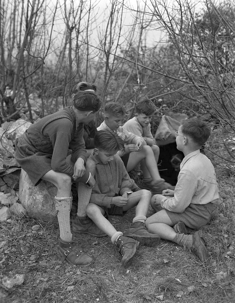 vintage boys playing outdoors in woods nature