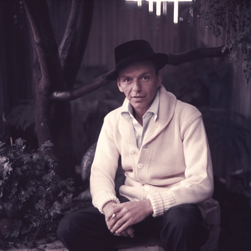 frank sinatra wearing cardigan and fedora