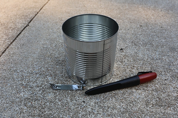 Hobo stove supplies tin can bottle opener knife.