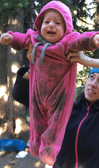 baby in outdoors pink fleece onesie crying