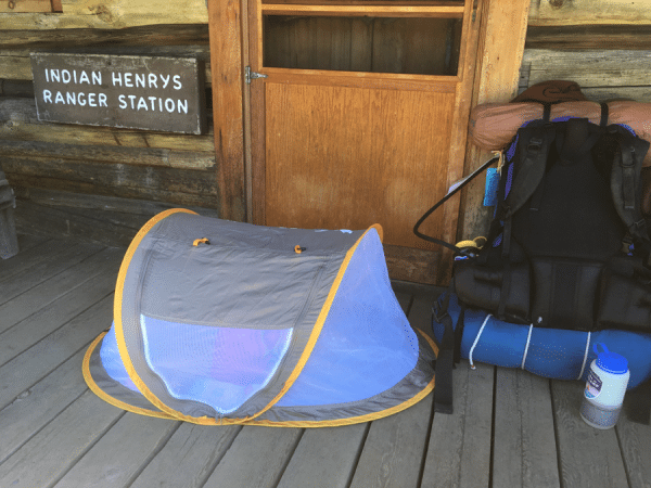 small kid's tent on front porch of park ranger station