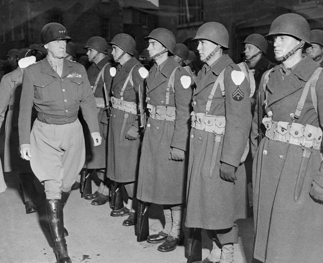 Patton inspecting line of soldiers.