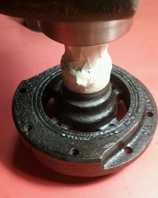 Rolling tape around the crankshaft.