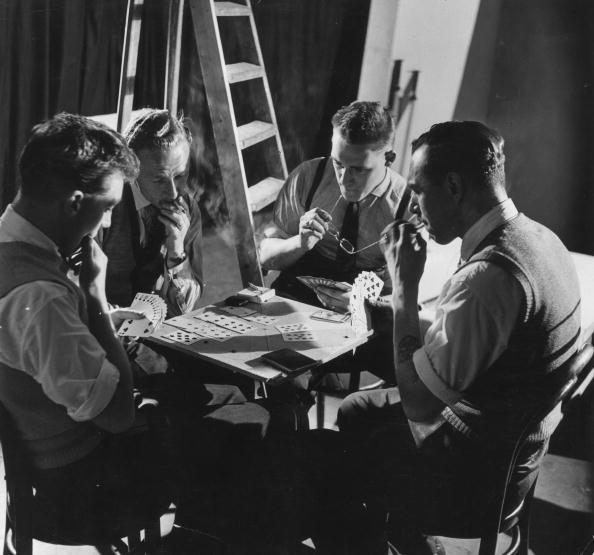 vintage men playing cards backstage