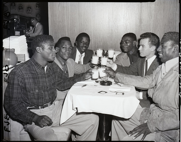 vintage young men giving toast