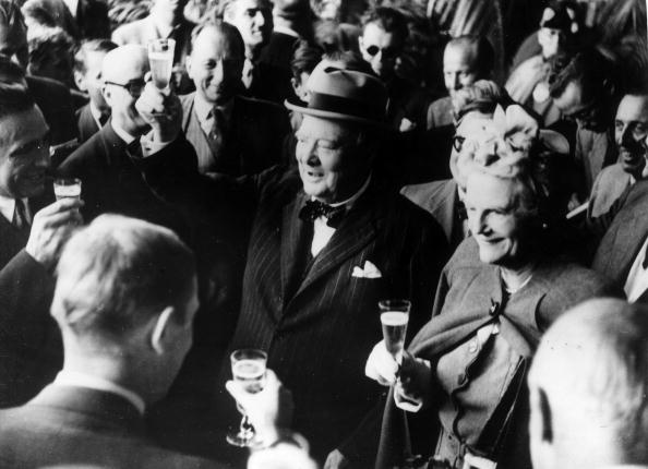 winston and clementine churchill giving a toast