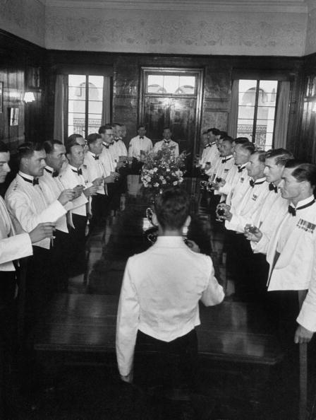 vintage group of men giving a toast