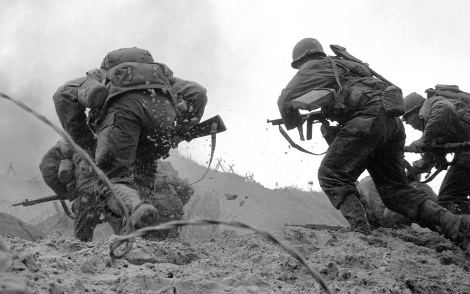 vintage soldiers going over hill into battle