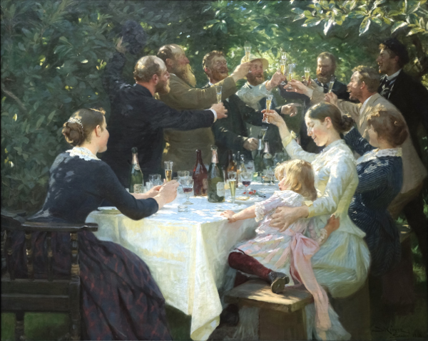Group of peoples giving a toast in open garden under the branches of trees.