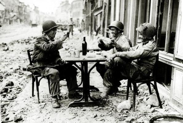 vintage soldiers toasting on war torn city street