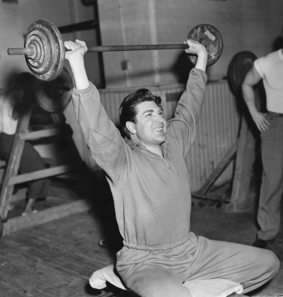 vintage man lifting barbell above his head