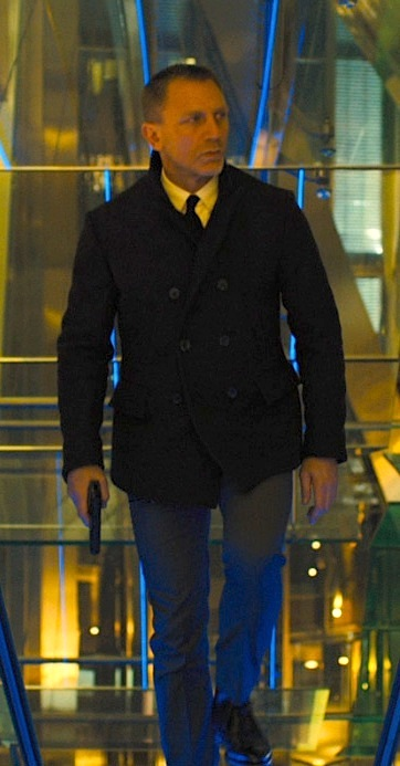 daniel craig james bond walking with pistol wearing pea coat