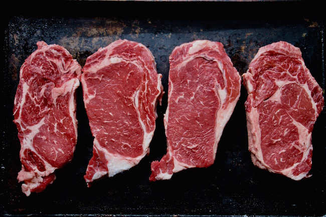Thick and uncooked beefs steaks displayed.