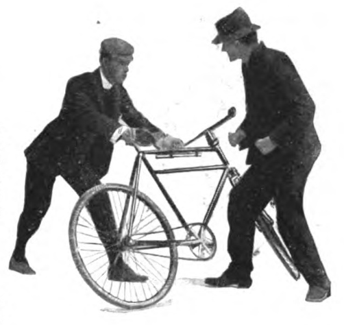 Vintage man protecting himself from another man with bicycle.