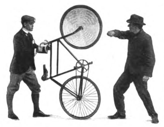 Vintage man lifting the front wheel of a bicycle in the air.