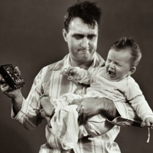 vintage man holding crying baby