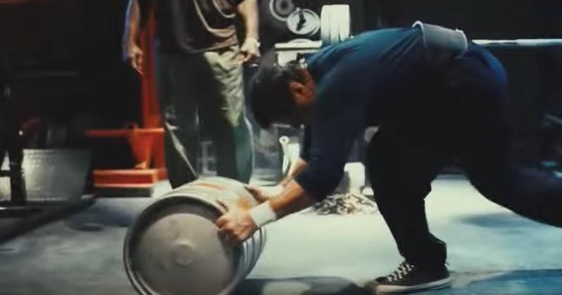 Rocky doing overhead keg slam.