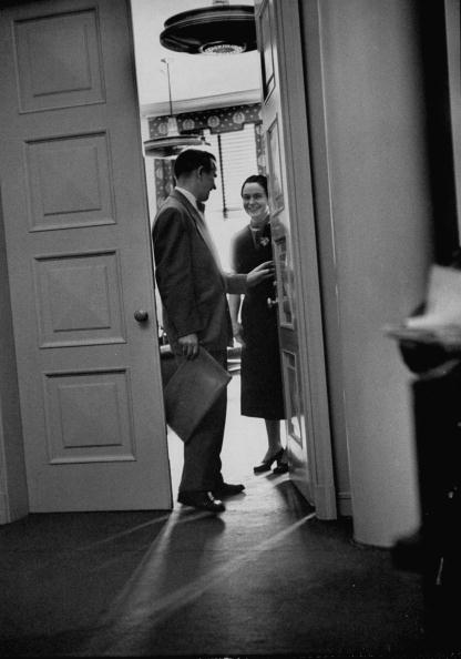 Businessman seeing off his wife for work.