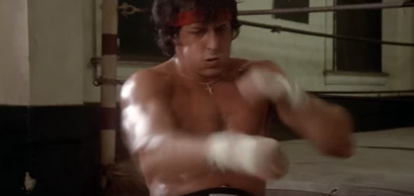 Rocky punching while doing sit-ups.