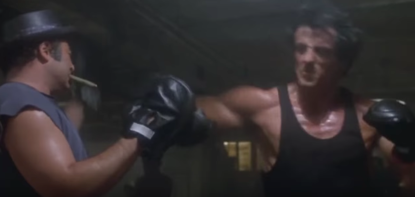 Rocky hitting pad in his movie.