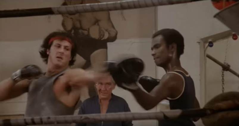 Rocky hitting the pads while training.