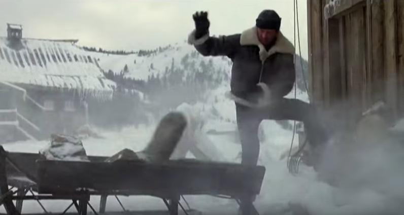 Rocky tossing rocks in snow.