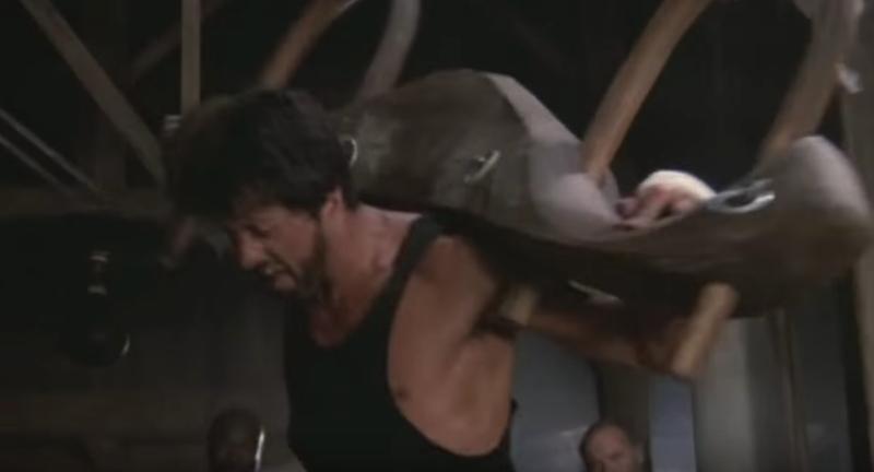 Rocky shouldering a wooden yoke.