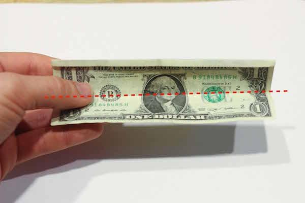 Folded dollar bill in half.