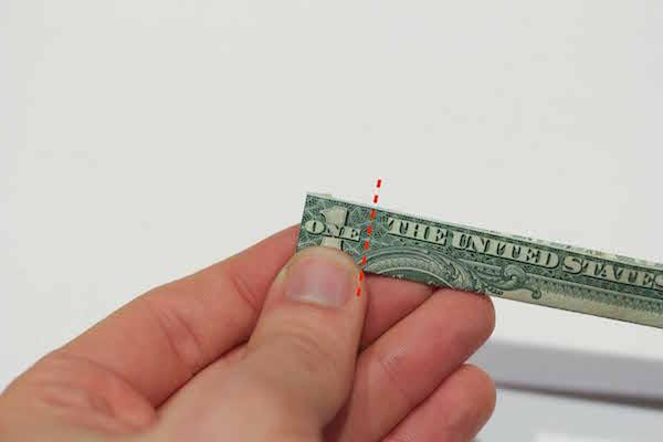 Folded left edge of one dollar bill.