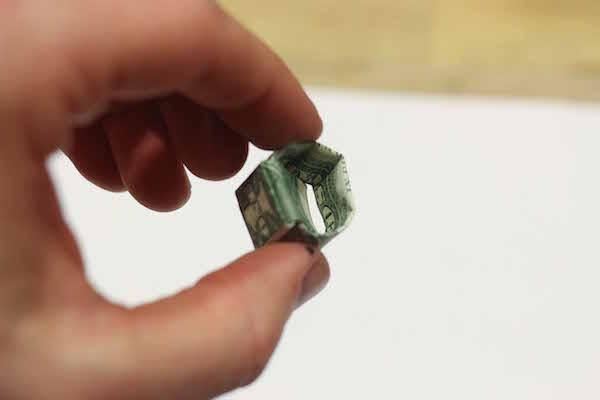 Ring made through one dollar bill.