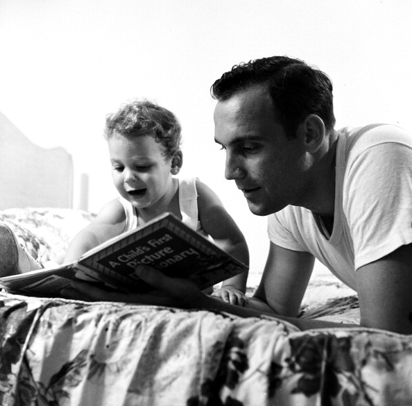 vintage dad reading with young son