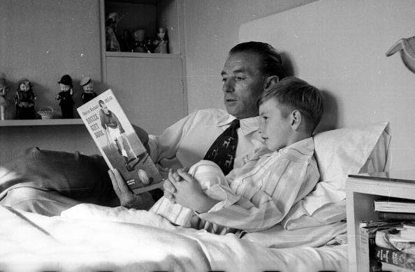 Vintage father telling story to his son.
