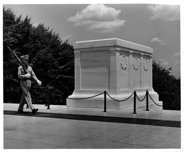Guard marching with tomb of the unknown soldier.