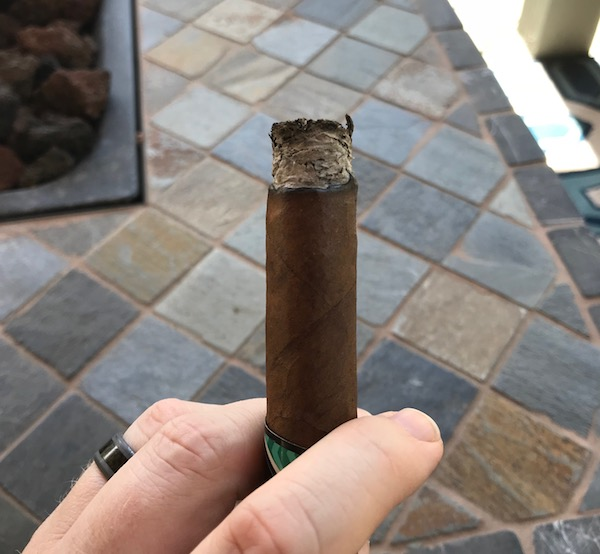 Gray ash on the foot of cigar.