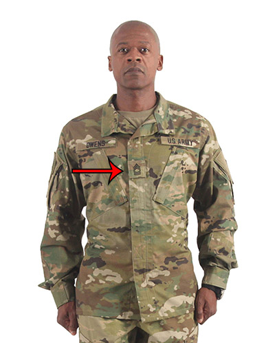 Combat soldier with badge on his chest.