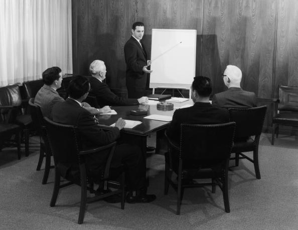 Vintage businessman leading a meeting.