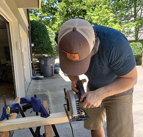 Man cutting wood.
