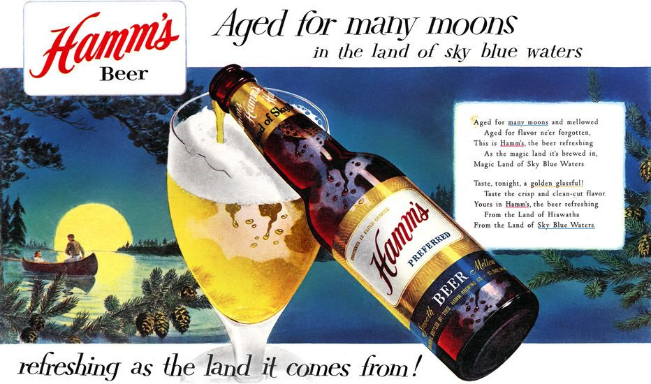 Bottle of Hamm's beer filling in a glass.